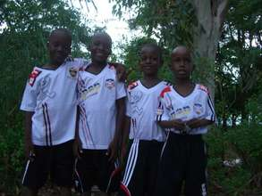 The four boys in their soccer uniforms