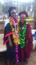 Alice celebrating graduation with a classmate