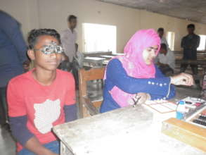 Doctor vision check of School children in Eye camp