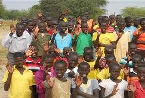 Girls awaiting uniforms with headmaster