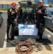 Hawai'i volunteers with recovered marine debris