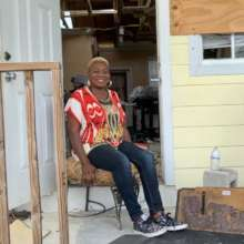 Pleasant in her home at Marsh Harbour, Abaco