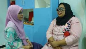 Aminah at the Eye Doctor