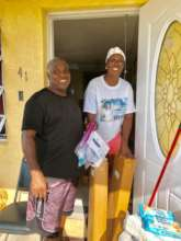 A family receiving relief supplies in Grand Bahama