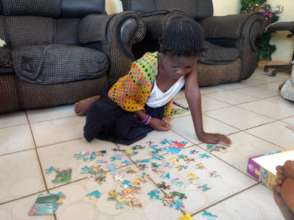 Jigsaw time at the Kimbilio girls home!