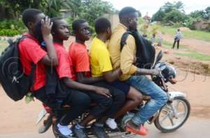 Going home from University on the Boda-Boda.