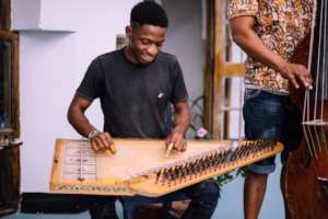 A DCMA student masters the traditional qanun.