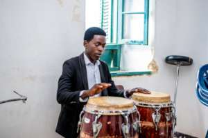 A DCMA student learns to play the drum