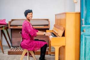 A DCMA student learns the piano