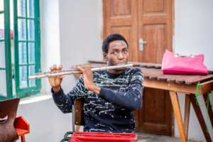 A DCMA student learns to play the flute