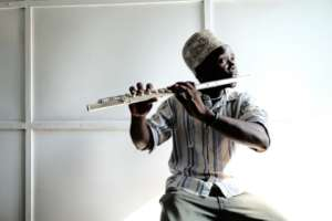 """""""Tofa Boy"""" learned to play flute at the DCMA."""