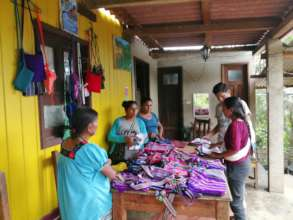 Women artisans showing their products