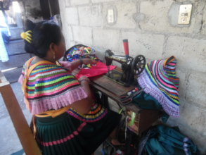 Woman sewing on pedal machine