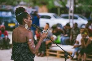 Valerie recites a poem at Nafasi in June