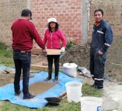 Monica, Rodrigo & Rene sieve sand before lockdown