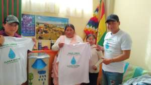 A family poses with their new biosand water filter