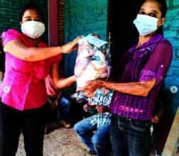 Leader in Tule, Honduras distributes food rations.