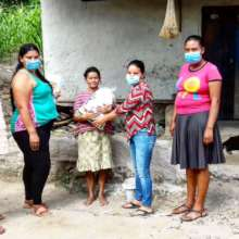 Community Leaders distribute food rations.