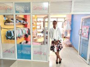 Linda in the doorway of  Little Smiles