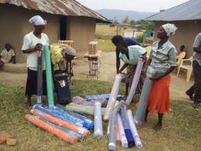 Women doing tailoring in paponditi