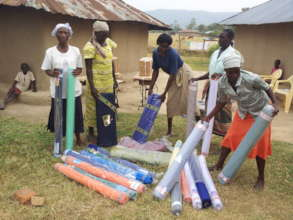 Women Recieving Materials for tailoring Project