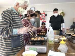 Cooking takoyaki at a Christmas event!