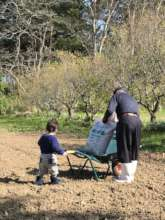 An skilled farmer and a child enjoying farming!