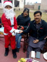 Child as Santa Clause giving sweets to guests