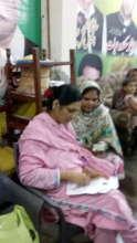 volunteers collecting data of families