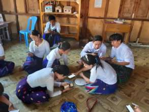 Students using MyLibrary in refugee camp in Kachin
