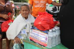 A helpless elderly joyful after receiving goods