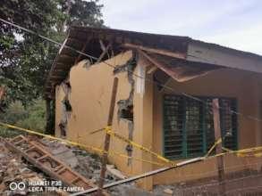 Severely destroyed building in Tulunan