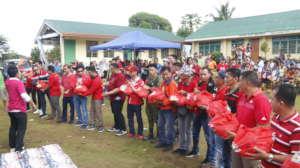 Volunteers passing relief goods