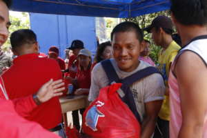 A happy father receiving relief goods