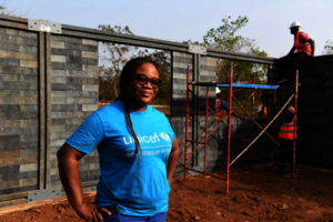 Sylviane, a UNICEF engineer, on site at a build