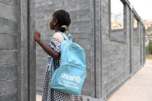 A girl is looking at her new school