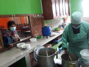 Rosalia cooking food for the families