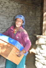 Women gets bee hive after beekeeping training