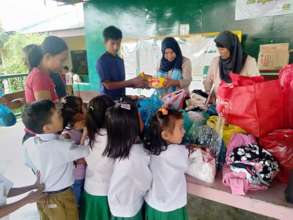 Children receiving supplies pre Covid-19
