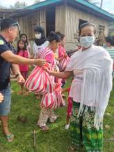 Families receive food, hygiene supplies and books