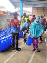 Families receive water, food, and hygiene supplies