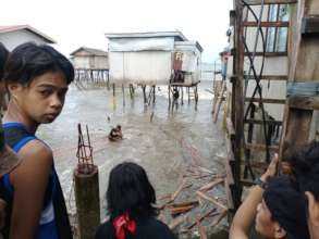 Thousands lose homes after earthquake storm surge