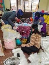 AAI volunteers assembling care packages