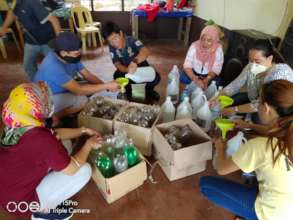 AAI Volunteers making care packages