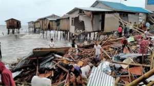 Families look for belongings after homes collapse