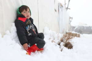 A child sitting on the snow