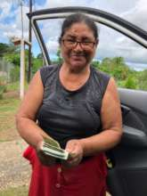 Community member receiving payment for production