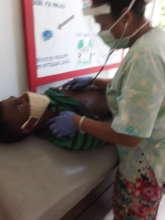 Dr. Elizabeth treating a patient