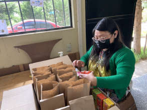 Teresa prepares kits for guests at our open house