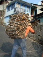 Every day women and men are carrying firewood